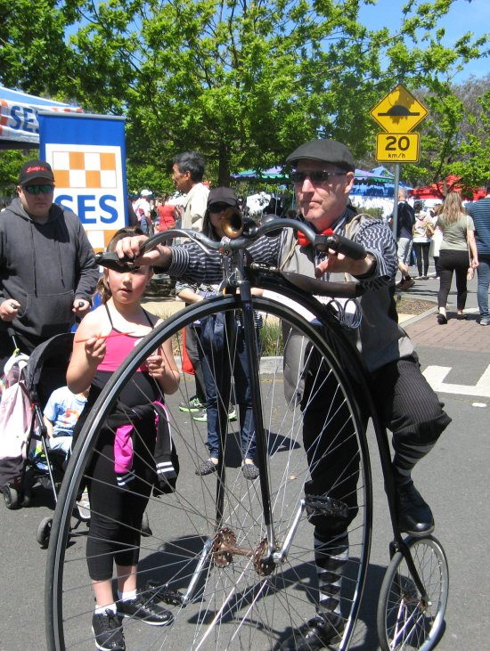 Murray mounting the Penny farthing